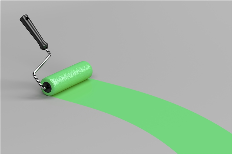 Painting with green paint on grey background