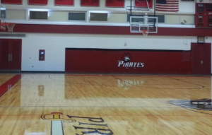Refinish a basketball court as part of painting your gym